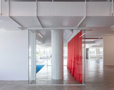 Red drapes partition stark white HUSH offices in Brooklyn Office Interior Design, Office Interiors, New York Office, Separating Rooms, Mediterranean Architecture, House Deck, May Designs, Red Curtains, Lounge Areas