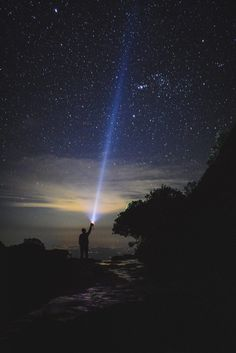 9 Astonishing Camping Appearance Man Holding Flashlight Pointing Towards Sky 7 Chakras, Effort, Search Party, Starry Night Sky, Night Photography, Hd Photos, Rocky Mountains, Night Time, Solar Power