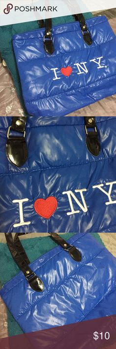 """I ❤️NY Blue Quilted Travel Bag This 17""""x13"""" quilted blue bag with I ❤️NT embroidered in front is super cute and practical for travel. The bag has a top zipper and while purse is in perfect never used condition.It has patent leather straps that fit at shoulder and look cute too. You will look like you have been somewhere or maybe you are staying at home and making a statement about where you would like to go! It is cute. I ❤️NY Bags Travel Bags"""