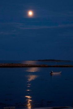"""A rising perigee Moon over the coast of Maine. (2013-07-21) The Moon has an elliptical orbit and it's at its closest point to the Earth at perigee. (Credit: Louis Suarato @Angela Gray Gray Bertasson Sixtine). Mona Evans, """"What Is a Supermoon?"""" http://www.bellaonline.com/articles/art180785.asp"""