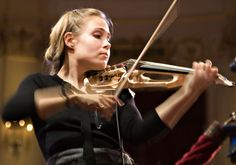 Leila Josefowicz (born October 20, 1977)  -  http://en.wikipedia.org/wiki/Leila_Josefowicz  -- (the photo via Marilee Bryant http://www.pinterest.com/pin/120189883779499909/ )