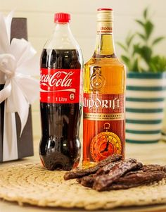 Buy or Send for the real South African at heart, this gift hamper contains a bottle of Klipdrift Export, Coke and a pack of delicious droewors in South Africa. Perfect Gift For Dad, Gifts For Dad, Same Day Delivery Service, Biltong, Alcohol Gifts, South African Recipes, Gift Hampers, Hot Sauce Bottles, Coke