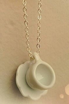"""Tiny Ceramic Cup and Saucer necklace. Irresistible!!! white on silver color chain. 17"""" long"""