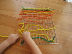 Weave pipe cleaners/chenille sticks onto a metal cooling rack for fine motor skills. Preschool activity while older children #homeschool  From jdanile4moms.com