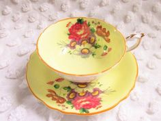 Vintage Paragon China Fancy Yellow Floral Teacup Wide Mouth Footed Double Warrant