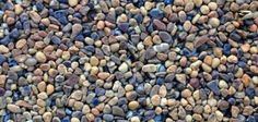 You can refurbish your aging concrete patio by resurfacing it with colorful pebbles embedded in epoxy resin.