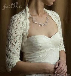 Pretty lacy bolero.  Looks like it's for a wedding dress cover up, but it could be dyed...