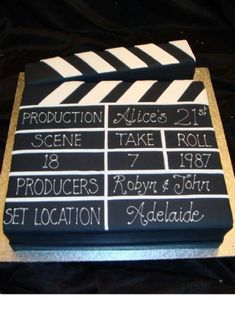 To go along with the movie themed party, enjoy the director's clapboard! Perfect for any celebration/event you throw! Simple, but yet creative.