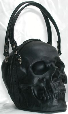 Welcome to Griffin Leather .  Hand formed leather skull clutch bag purse. The leather is formed and tempered to keep its shape. It also has fiberglass/resin enforcement where needed. Hand stitching finished off the borders where the 2 half's meet. A magnetic clasp holds the skull together and it is lined with a dense felt. This one has been air brushed black and has an acrylic clear coat as well. This version uses nickel plated hardware with a leather straps. The measurements are about 6 1/2…