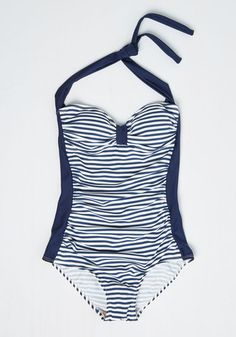 Without saying a word, you express your pull toward la plage by slipping into this striped swimsuit! A Bettie Page style, this navy and white wonder showcases hints of retro haute with its halter neckline, cinched bust, and flattering ruched sides. Can't 'tide' your desires in this one!
