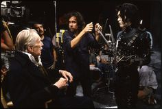 """Tim Burton chats with Johnny Depp and Vincent Price during filming for one of Edward's flashbacks. 