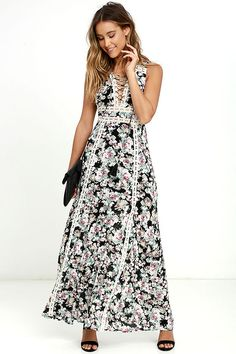 There's no doubt that the Sun Will Shine Black Floral Print Maxi Dress brings rays of sunshine wherever it goes! Black woven rayon has a cream, blush pink, light blue, and sage floral print over a sleeveless, lace-up bodice, and open back with top button. Crocheted lace travels into the maxi skirt. Hidden back zipper/clasp.
