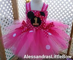 Beautiful Minnie mouse inspired tutu dress. Very fun and fluffy. Has many layers of pink and fuschia tulle for extra coverage and fluffiness. And of course couldn't left the polka dots out!! Front of
