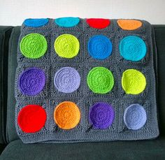 cheery crochet blanket with colored spheres