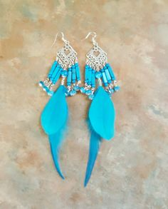 Beautiful Sky Blue Feather and Howlite and Crazy Lace Agate Dangle Earrings by WolfMountainJewelry on Etsy  22.00