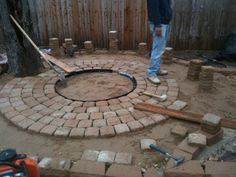 Laying out the bricks for the bonfire place