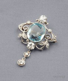 Aquamarine and Diamond Pendant/Brooch, bezel-set with a cushion-cut aquamarine measuring 12.90 x 11.60 x 5.65 mm, within a scrolling mount set with old European-cut diamonds, approx. total diamond wt. 1.40 cts., platinum-topped gold and platinum mount, suspended from a later silver chain, lg. 1 5/8 in.