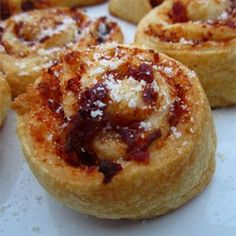 """Sun-Dried Tomato Palmiers   """"Flaky/crispy dough filled with savory sun-dried tomato filling, and topped with grated Parmesan cheese. Perfect appetizer for a fancy get together. No one has to know how easy they are to make!"""""""