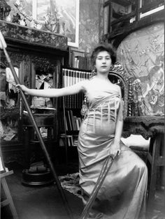 Model posing in Mucha's studio