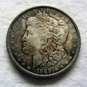 Photo about Morgan Silver Dollar, US Currency. Image of coinage, currency, states - 459651