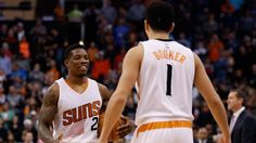 #NBA DECEMBER 09:  Eric Bledsoe #2 of the Phoenix Suns celebrates with Devin Booker #1 during the final moments of the NBA game against the Orlando Magic at Talking Stick Resort Arena on December 9, 2015 in Phoenix, Arizona.  The Suns defeated the Magic 107-104. NOTE TO USER: User expressly acknowledges and agrees that, by downloading and or using this photograph, User is consenting to the terms and conditions of the Getty Images License Agreement.  (Photo by Christian Petersen/Gett...