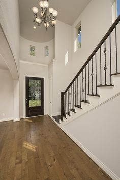Perry Homes Grand Entrances - 3,098 Sq. Ft. #PerryHomes #trustedbuilder #homebuying #homebuilding #HoustonHomes #SanAntonioHomes #HillCountryHomes #openconcept #openfloorplan #familyhome #realestate #RelocatedtoHouston #energycorridor #woodfloors #hardwood #foyer #entry #grandstaircase #hallway #staircase #livingspace
