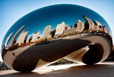"""Cloud Gate (2006), view #1, Millennium Park, Chicago.   Polished stainless steel sculpture aka """"The Bean"""" or """"The Silver Bean,"""" by Indian-born British artist Anish Kapoor"""