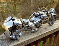 Chopper Motorcycle Sculptures made from Spoons. To see more art and information about James Rice click the image.