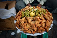 Street Food of Hyderabad (Samosas with fried green chillies and lemon) by iHyd, via Flickr