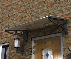 Glass Door Canopy with scroll brackets. Complies with UK Snow load and wind pressure tests.