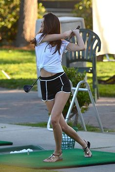 Kendall Jenner wearing Chanel CC White Leather Thong Sandals.