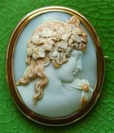 Cameo ... different with the face matching the background and just the hair and vine and toga colored
