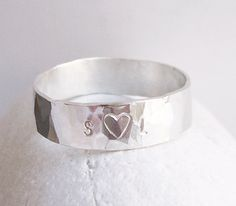 Wide Hammered Sterling Silver Ring $95.00, via Etsy.