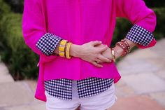 a fitted patterned button up under a flowy bright one