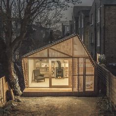 Light glows through the cedar facade of Writers Shed by Weston Surman & Deane - dezeen