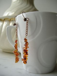Carnelian chip dangly earrings on antique copper colured chain and shepherd hooks.  Genuine gemstones.  £9.95 by CalicoRoseStudio on Etsy