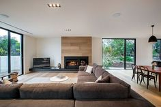 Blairgowrie Residence by InForm Design & Pleysier Perkins  address the tv issue and the need for extra chairs - but yes...