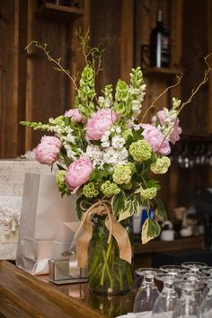 Peonies Floral Arrangement- Peony rustic centerpiece with a burlap bow! LOVE LOVE LOVE!