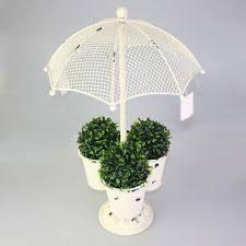 435caaa8ff84 Resultado de imagen para diseños de paraguas de hierro de adornos para el  jardín Paraguas,