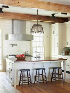 Island Storage All Around--Each side of this island is packed with storage, even beneath the eating counter. The side where the barstools are stationed houses roomy cabinetry storage. While accessing these cabinets requires moving the stools, the spot is ideal for stashing infrequently used items such as roasting pans, large serving platters, and some small appliances