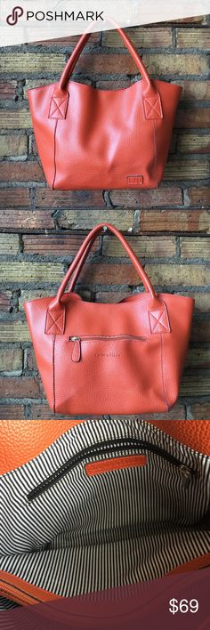 "LOUENHIDE Orange Pebble Leather tote Excellent condition!! There is a black mark I took a picture of on the back left corner. Barely noticeable! 17"" long 11"" tall. Huge main compartment with a striped lining. LouenHide Bags Totes"