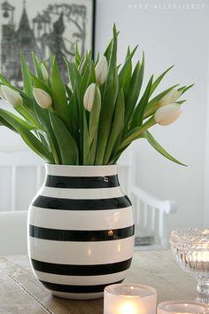 Tulips are a great spring flower. For a simplistic look choose a simple patterned vase with white flowers. Let the green from the stems be your color focal point.