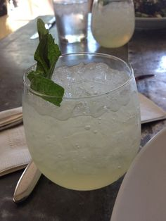 White Wine Mojito; Tiny Boxwood's Recipe: 1 bottle white wine, 1 cup sparkling lemonade, 1 cup chopped mint leaves, 2 limes (sliced and juiced).