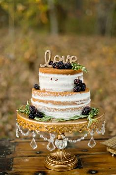 Stunning naked cake with gold topper. Glamourous Forest Wedding Shoot by Andie Freemand via @FlyAwayBride