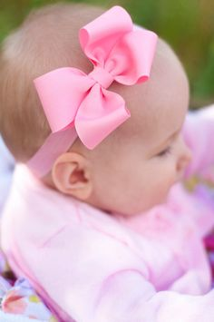 Super cute single layer loopy bow attached to soft headband.