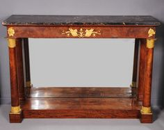 A French Empire ormolu-mounted mahogany console table with portor marble top, circa 1815 - Antiques | ArtListings