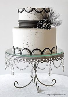 Darcy (this retro chic cake was made for a black, white and silver themed wedding reception.) made by The Pastry Studio