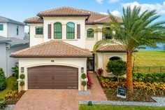 Somerset Grande Plan   Florida Real Estate - GL Homes Concrete Roof Tiles, Undermount Stainless Steel Sink, Modern House Floor Plans, Boca Raton Florida, Iron Balusters, Glass Shower Enclosures, House Elevation, Front Elevation, Wood Stairs