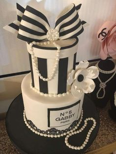 What an amazing birthday cake at this gorgeous Chanel Birthday Party!! Love the bow on top!! See more party ideas and share yours at CatchMyParty.com