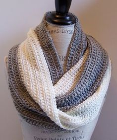 This infinity scarf is simple to work using a variation of the single crochet stitch. It creates a great drape and nice swirl of colors. It is a great project for beginners and novices.: